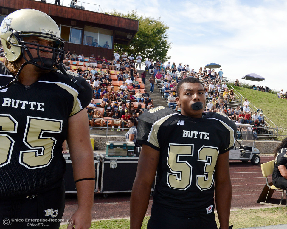 Description of . Butte College's #65 Tyler Anglin (left) and #53 Ahmad Logan (right) against Delta College in the second quarter of their football game at Butte's Cowan Stadium Saturday, September 28, 2013, in Oroville, Calif.  (Jason Halley/Chico Enterprise-Record)