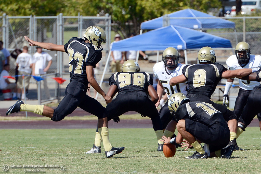 Description of . Butte College's #27 Rigoberto Sanchez (left) kicks the extra point against Delta College in the first quarter of their football game at Butte's Cowan Stadium Saturday, September 28, 2013, in Oroville, Calif.  (Jason Halley/Chico Enterprise-Record)