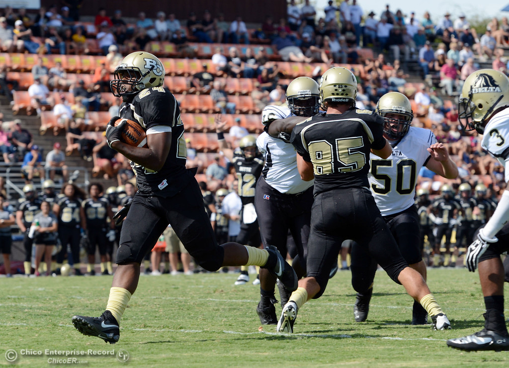 Description of . Butte Colleges' #24 Kendall Williams (left) rushes for a touchdown against Delta College in the second quarter of their football game at Butte's Cowan Stadium Saturday, September 28, 2013, in Oroville, Calif.  (Jason Halley/Chico Enterprise-Record)