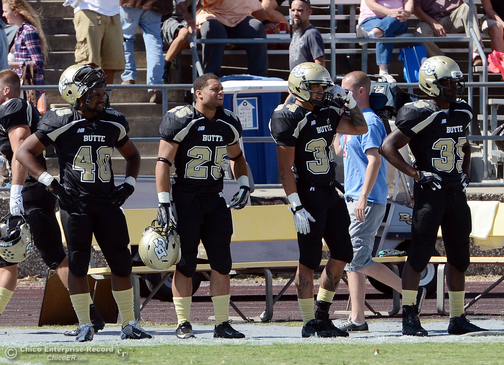Description of . Butte College's #40 Victor Washington, #25 De'Aundray Gooden, #34 Michael Rabara, and #35 Zach Williams look on from the sidelines against Delta College in the first quarter of their football game at Butte's Cowan Stadium Saturday, September 28, 2013, in Oroville, Calif.  (Jason Halley/Chico Enterprise-Record)