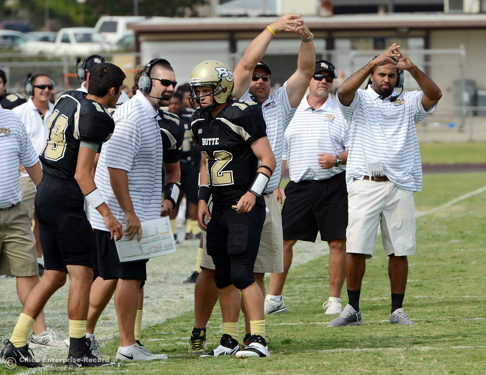 Description of . Butte College coaches make the calls against Delta College in the third quarter of their football game at Butte\'s Cowan Stadium Saturday, September 28, 2013, in Oroville, Calif.  (Jason Halley/Chico Enterprise-Record)