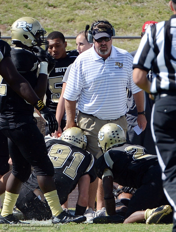 . Butte College head coach Jeff Jordan (top) looks on against Delta College in the first quarter of their football game at Butte\'s Cowan Stadium Saturday, September 28, 2013, in Oroville, Calif.  (Jason Halley/Chico Enterprise-Record)