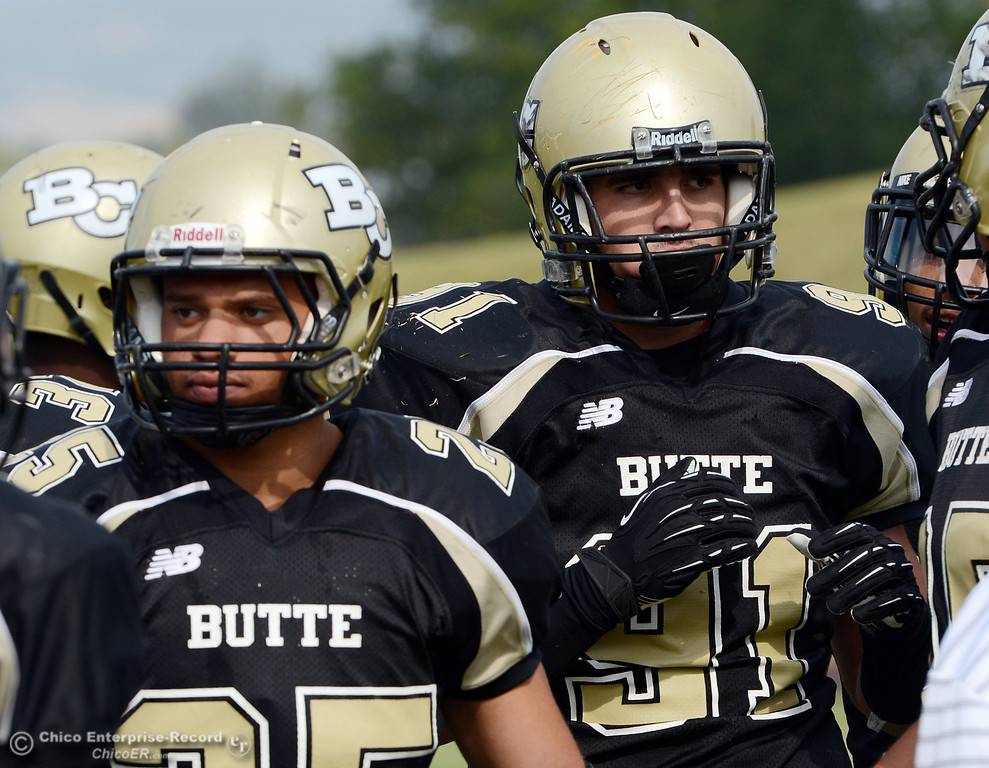 Description of . Butte College\'s #25 De\'Aundray (left) and #91 Miek Fratianni (right) looks on against Delta College in the fourth quarter of their football game at Butte\'s Cowan Stadium Saturday, September 28, 2013, in Oroville, Calif.  (Jason Halley/Chico Enterprise-Record)