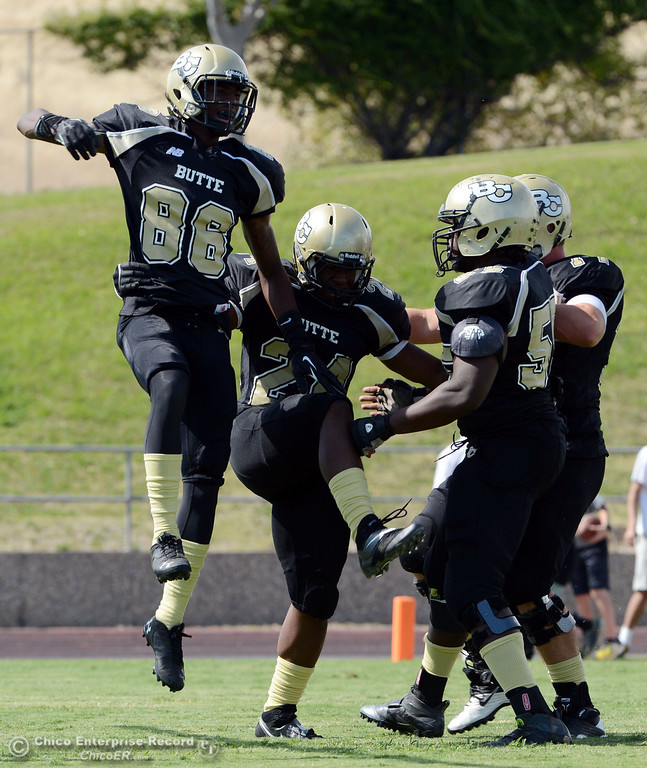 Description of . Butte Colleges' #86 Jon Parks (left) celebrates with #24 Kendall Williams (right) after he rushed for a touchdown against Delta College in the second quarter of their football game at Butte's Cowan Stadium Saturday, September 28, 2013, in Oroville, Calif.  (Jason Halley/Chico Enterprise-Record)