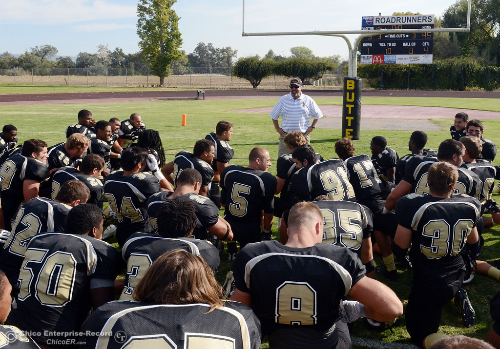 Description of . Butte College\'s coach Jeff Jordan speaks to the team against Delta College at the end of their football game at Butte\'s Cowan Stadium Saturday, September 28, 2013, in Oroville, Calif.  (Jason Halley/Chico Enterprise-Record)