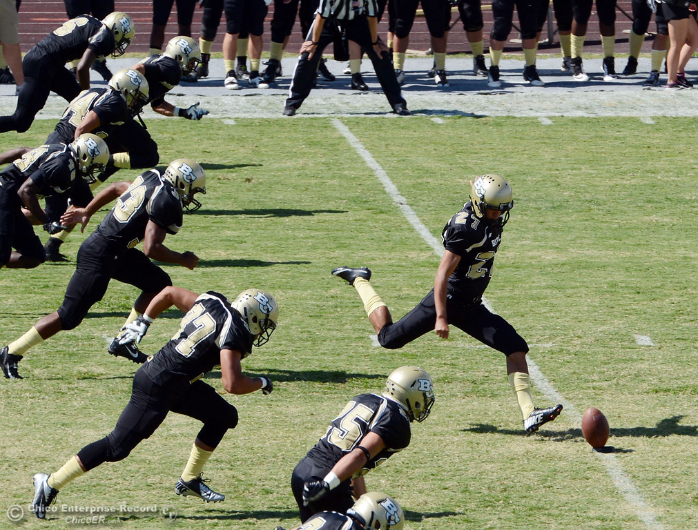 . Butte College\'s #27 Rigoberto Sanchez (center) kicks off against Delta College in the first quarter of their football game at Butte\'s Cowan Stadium Saturday, September 28, 2013, in Oroville, Calif.  (Jason Halley/Chico Enterprise-Record)