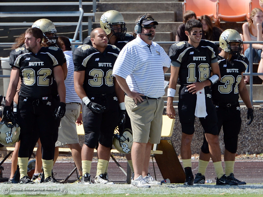 Description of . Butte College head coach Jeff Jordan looks on from the sidelines against Delta College in the first quarter of their football game at Butte's Cowan Stadium Saturday, September 28, 2013, in Oroville, Calif.  (Jason Halley/Chico Enterprise-Record)