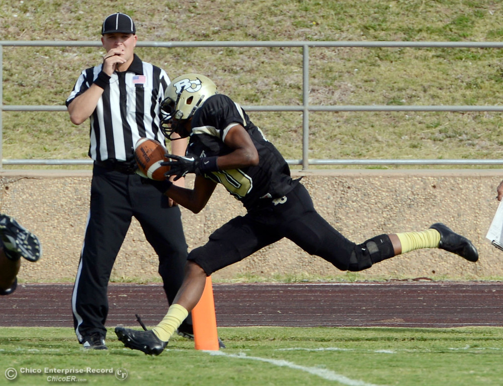Description of . Butte College's #10 CJ Grice makes a complete catch in the endzone, but was called back for a flag for holding against Delta College in the fourth quarter of their football game at Butte's Cowan Stadium Saturday, September 28, 2013, in Oroville, Calif.  (Jason Halley/Chico Enterprise-Record)