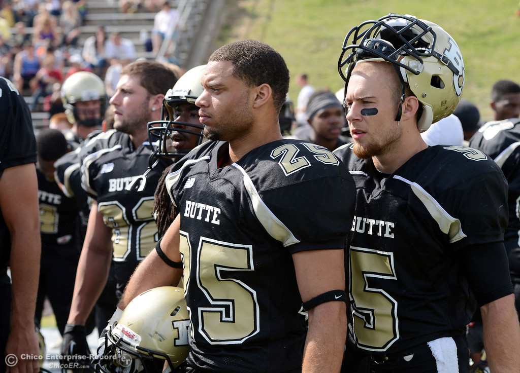 Description of . Butte College's #25 De'Aundrey Gooden (left) and #5 David Brannon look on against Delta College in the second quarter of their football game at Butte's Cowan Stadium Saturday, September 28, 2013, in Oroville, Calif.  (Jason Halley/Chico Enterprise-Record)