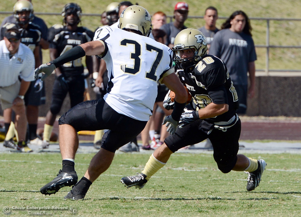 Description of . Butte College\'s #20 Armand Bokitch (right) rushes against Delta College\'s #37 Chris Davi (left) in the second quarter of their football game at Butte\'s Cowan Stadium Saturday, September 28, 2013, in Oroville, Calif.  (Jason Halley/Chico Enterprise-Record)