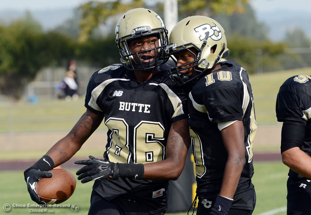 Description of . Butte College's #86 Jon Parks (left) is congratulated by #10 CJ Grice (right) after Parks scored a touchdown against Delta College in the fourth quarter of their football game at Butte's Cowan Stadium Saturday, September 28, 2013, in Oroville, Calif.  (Jason Halley/Chico Enterprise-Record)
