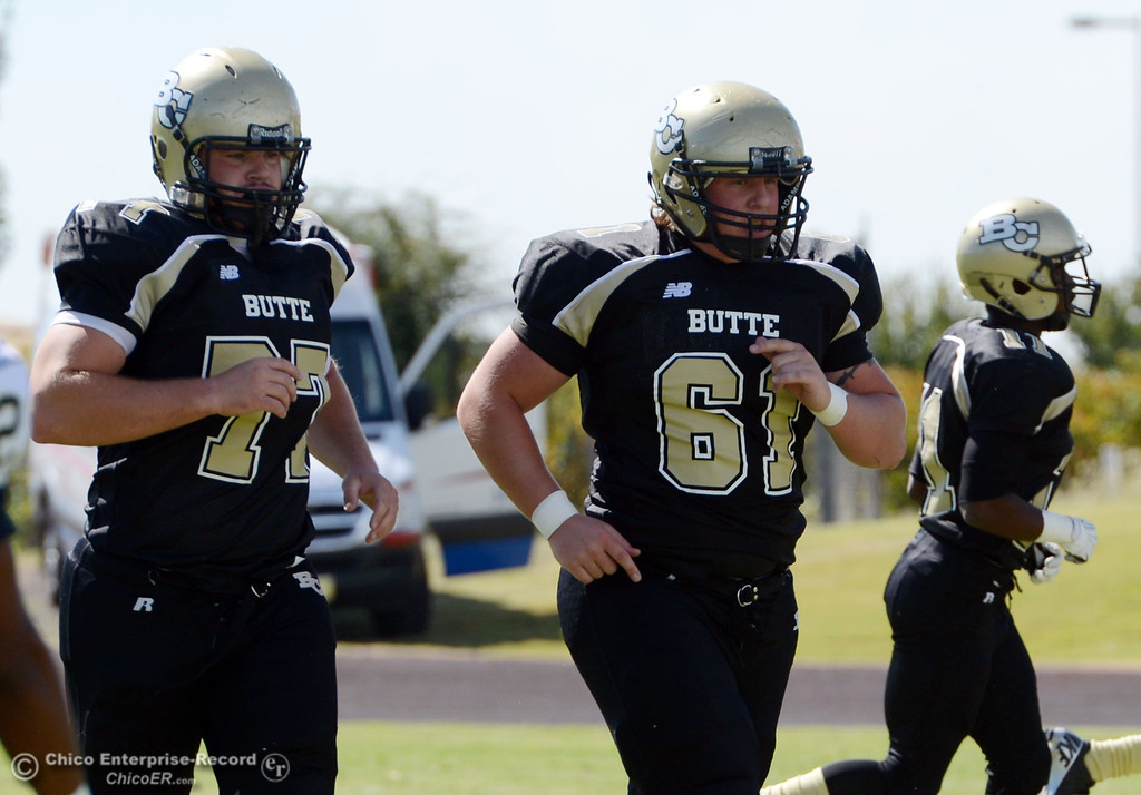 Description of . Butte College's #77 Scott Batchelder (left) and #61 Jacob Bigham (right) against Delta College in the first quarter of their football game at Butte's Cowan Stadium Saturday, September 28, 2013, in Oroville, Calif.  (Jason Halley/Chico Enterprise-Record)