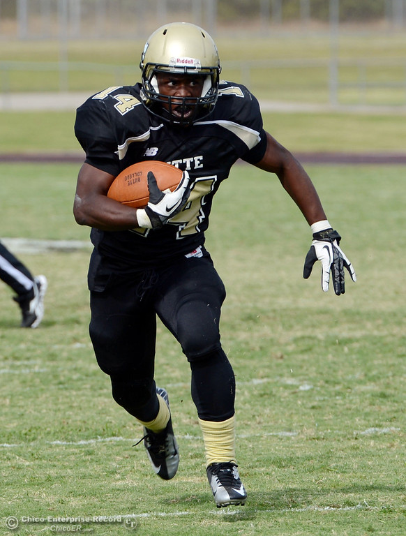 Description of . Butte Colleges\' #14 Robert Frazier rushes against Delta College in the third quarter of their football game at Butte\'s Cowan Stadium Saturday, September 28, 2013, in Oroville, Calif.  (Jason Halley/Chico Enterprise-Record)