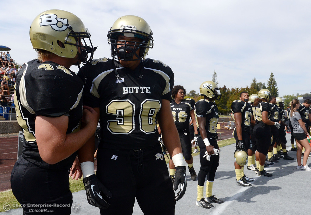 Description of . Butte College's #44 Casey Gingerich (left) and #38 Marcus McDonald (right) look on against Delta College in the second quarter of their football game at Butte's Cowan Stadium Saturday, September 28, 2013, in Oroville, Calif.  (Jason Halley/Chico Enterprise-Record)