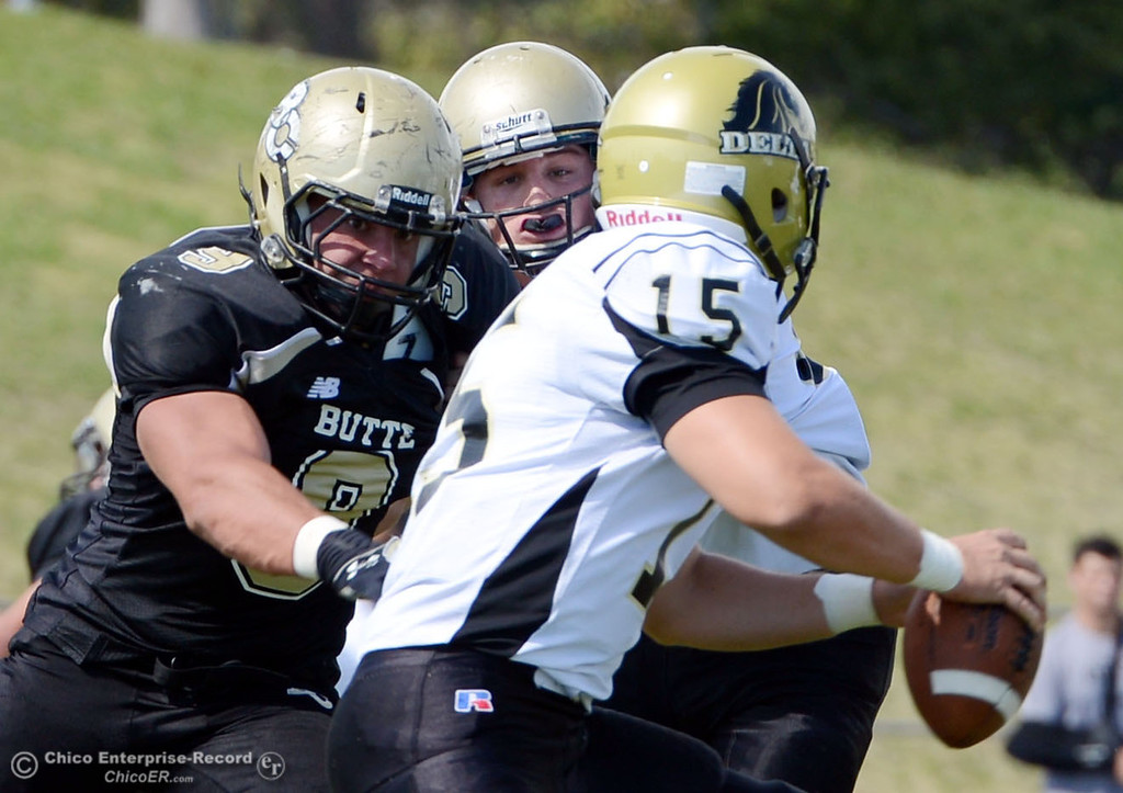 Description of . Butte College's #9 Tyler Adair (left) sacks against Delta College's #15 Cody Weinzheimer (right) in the second quarter of their football game at Butte's Cowan Stadium Saturday, September 28, 2013, in Oroville, Calif.  (Jason Halley/Chico Enterprise-Record)