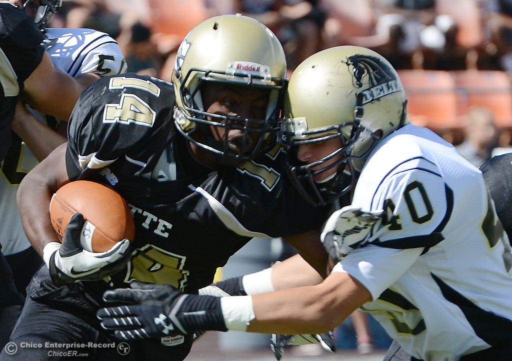 Description of . Butte College\'s #14 Robert Frazier (left) is tackled against Delta College\'s #40 Adrian Ramos (right) in the first quarter of their football game at Butte\'s Cowan Stadium Saturday, September 28, 2013, in Oroville, Calif.  (Jason Halley/Chico Enterprise-Record)