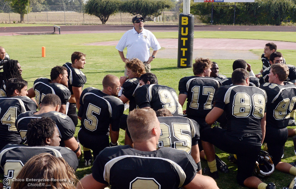 Description of . Butte College's head coach Jeff Jordan (center) congratulates the team against Delta College at the end of their football game at Butte's Cowan Stadium Saturday, September 28, 2013, in Oroville, Calif.  (Jason Halley/Chico Enterprise-Record)