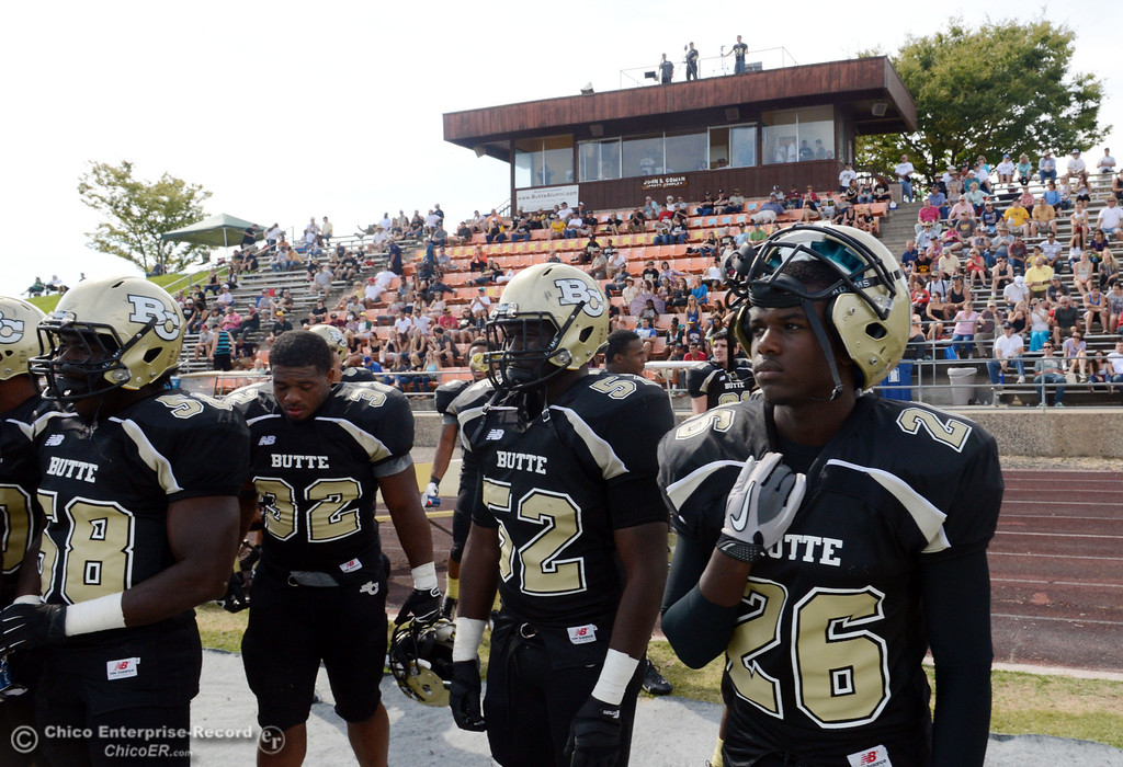 Description of . Butte College's #58 Sie Doe Jr., #32 Brian Anderson, #52 Kyjuan Tate, and #26 John Beckerleg (left to right) look on against Delta College in the second quarter of their football game at Butte's Cowan Stadium Saturday, September 28, 2013, in Oroville, Calif.  (Jason Halley/Chico Enterprise-Record)