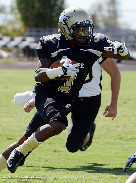 Description of . Butte College\'s #1 Wes McCoy rushes against Delta College in the first quarter of their football game at Butte\'s Cowan Stadium Saturday, September 28, 2013, in Oroville, Calif.  (Jason Halley/Chico Enterprise-Record)
