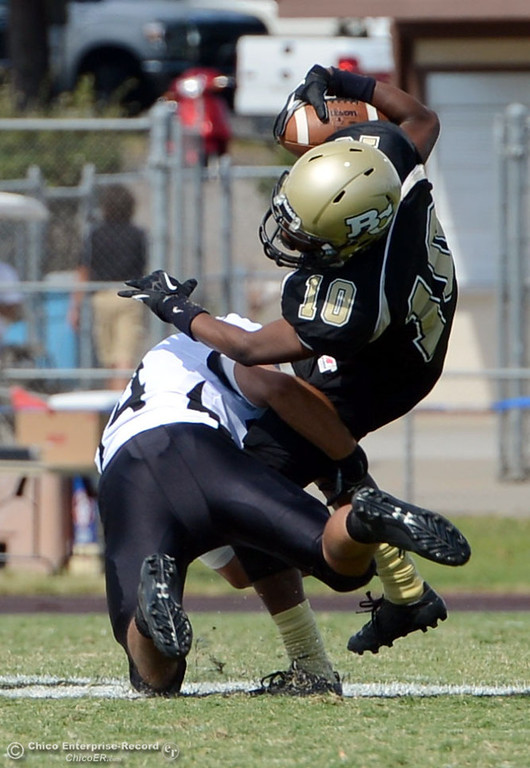 Description of . Butte College\'s #10CJ Grice (right) is tackled against Delta College\'s #34 Omar Lopez (left) in the second quarter of their football game at Butte\'s Cowan Stadium Saturday, September 28, 2013, in Oroville, Calif.  (Jason Halley/Chico Enterprise-Record)