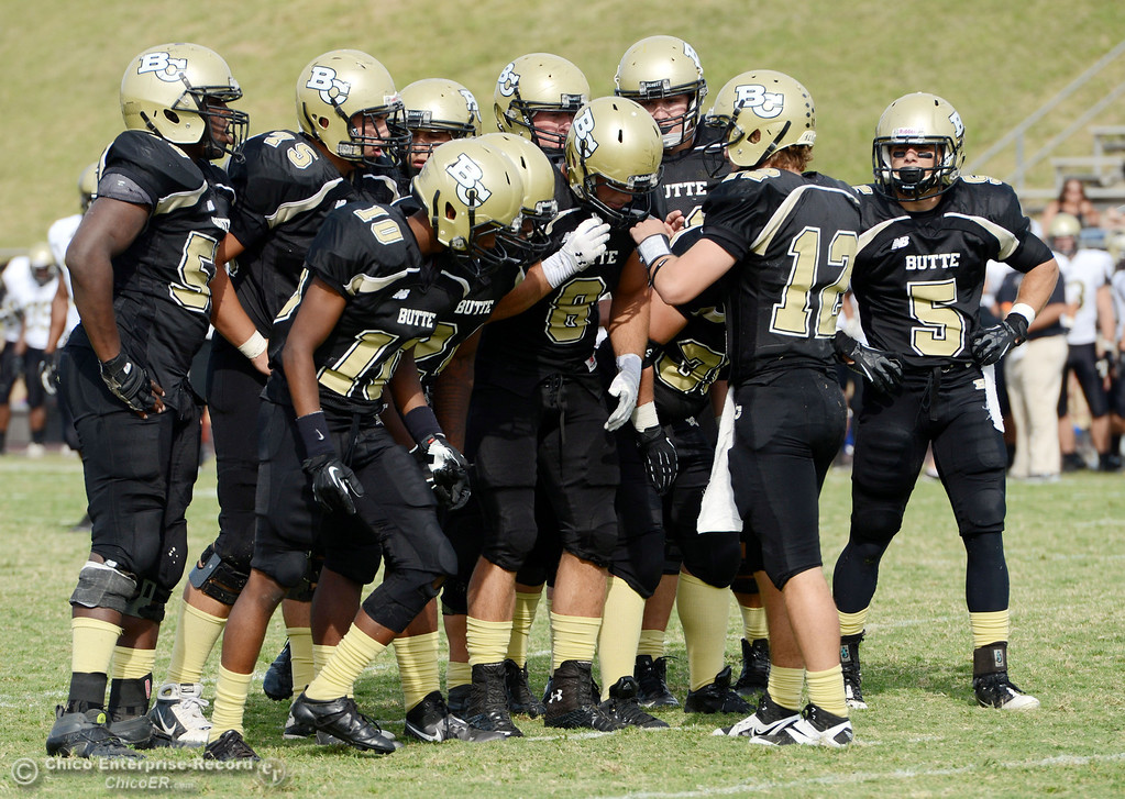 . Butte College #12 Thomas Stuart (right) readies the play against Delta College in the fourth quarter of their football game at Butte\'s Cowan Stadium Saturday, September 28, 2013, in Oroville, Calif.  (Jason Halley/Chico Enterprise-Record)