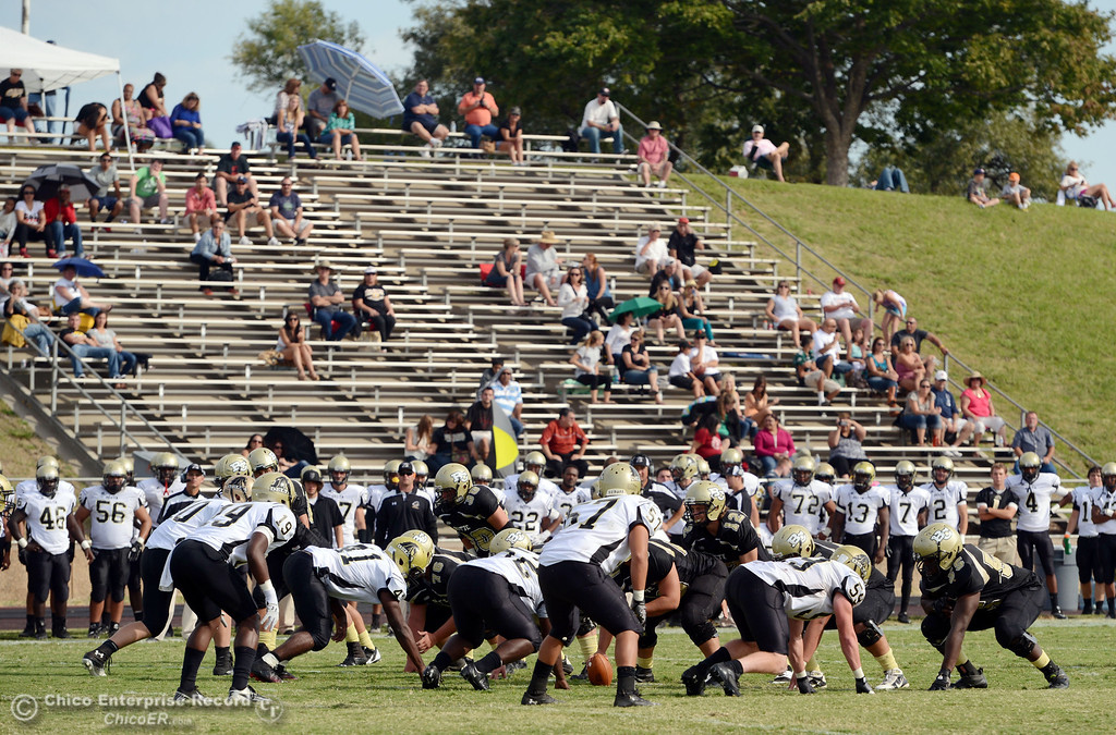Description of . Butte College against Delta College in the fourth quarter of their football game at Butte\'s Cowan Stadium Saturday, September 28, 2013, in Oroville, Calif.  (Jason Halley/Chico Enterprise-Record)