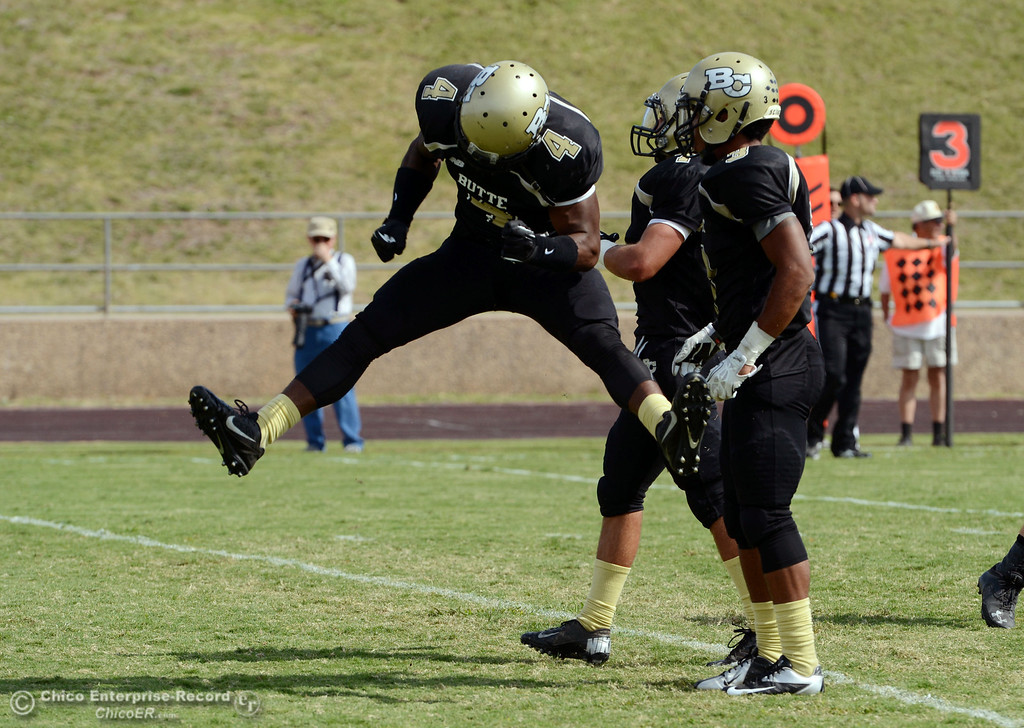 . Butte College\'s #4 Chris Edwards (left) reacts to coming up short on a interception attempt next to #3 London Muse (right) against Delta College in the second quarter of their football game at Butte\'s Cowan Stadium Saturday, September 28, 2013, in Oroville, Calif.  (Jason Halley/Chico Enterprise-Record)