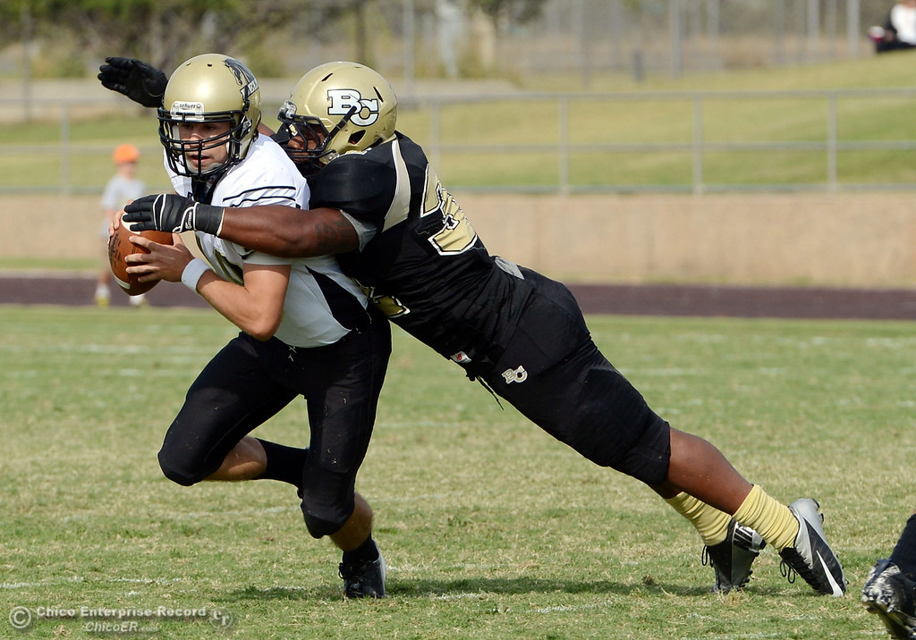 Description of . Butte College\'s #32 Brian Anderson (right) sacks against Delta College\'s #18 Merlin Bowen (left) in the fourth quarter of their football game at Butte\'s Cowan Stadium Saturday, September 28, 2013, in Oroville, Calif.  (Jason Halley/Chico Enterprise-Record)