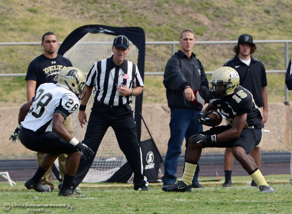 Description of . Butte Colleges' #15 Jalen Amis rushes against Delta College in the fourth quarter of their football game at Butte's Cowan Stadium Saturday, September 28, 2013, in Oroville, Calif.  (Jason Halley/Chico Enterprise-Record)