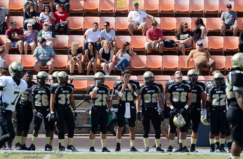 Description of . Butte College's #50 Joshua Womley, #26 John Beckerleg, #37 Demetre Lopez, #25 De'Aundray Gooden, #18 Eric Ascensio, #82 Greg Cannon, #88 Ralph Raetz, #8 Bo Brummel, #22 Quinta Thomas (left to right) against Delta College in the first quarter of their football game at Butte's Cowan Stadium Saturday, September 28, 2013, in Oroville, Calif.  (Jason Halley/Chico Enterprise-Record)