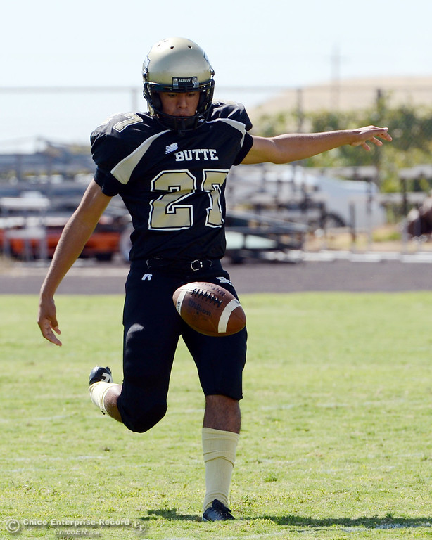 Description of . Butte College's #27 Rigoberto Sanchez punts away against Delta College in the first quarter of their football game at Butte's Cowan Stadium Saturday, September 28, 2013, in Oroville, Calif.  (Jason Halley/Chico Enterprise-Record)
