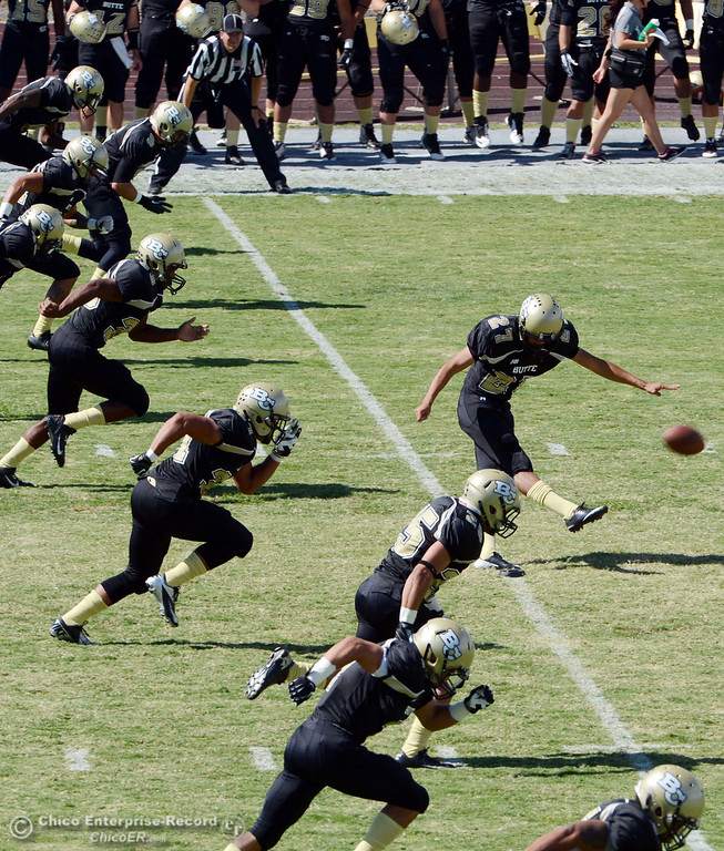 Description of . Butte College's #27 Rigoberto Sanchez (center) kicks off against Delta College in the first quarter of their football game at Butte's Cowan Stadium Saturday, September 28, 2013, in Oroville, Calif.  (Jason Halley/Chico Enterprise-Record)