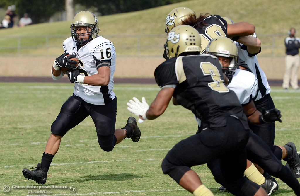 Description of . Delta College\'s #16 JaVaughn Iverson (left) rushes against Butte College in the fourth quarter of their football game at Butte\'s Cowan Stadium Saturday, September 28, 2013, in Oroville, Calif.  (Jason Halley/Chico Enterprise-Record)