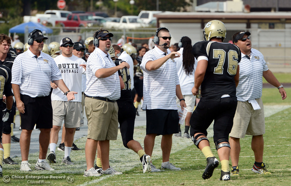 Description of . Butte College's head coaches congratulate the team a touchdown against Delta College in the third quarter of their football game at Butte's Cowan Stadium Saturday, September 28, 2013, in Oroville, Calif.  (Jason Halley/Chico Enterprise-Record)
