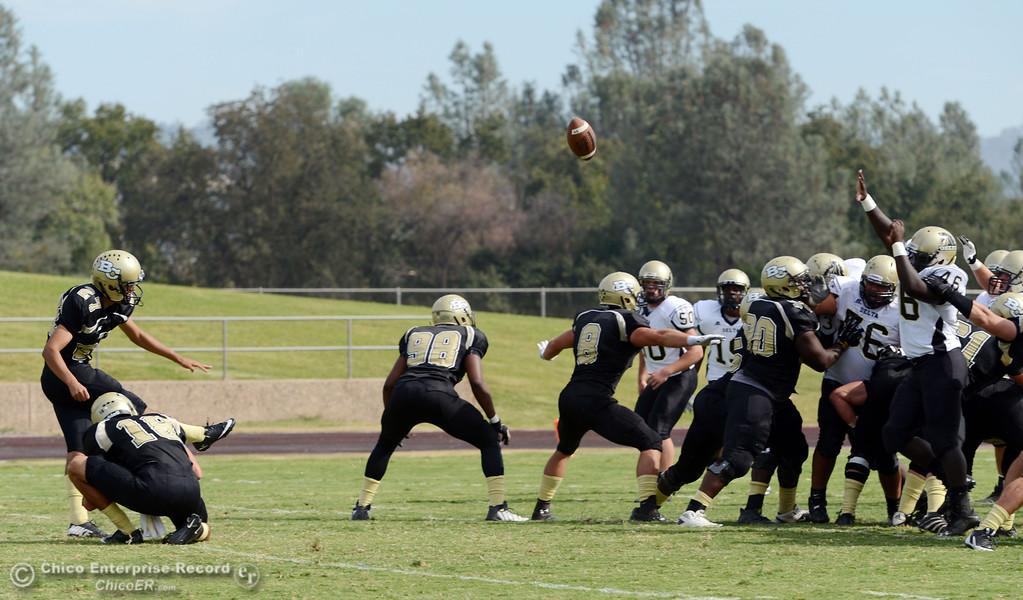 Description of . Butte College's #27 Rigoberto Sanchez kicks the extra point against Delta College in the third quarter of their football game at Butte's Cowan Stadium Saturday, September 28, 2013, in Oroville, Calif.  (Jason Halley/Chico Enterprise-Record)