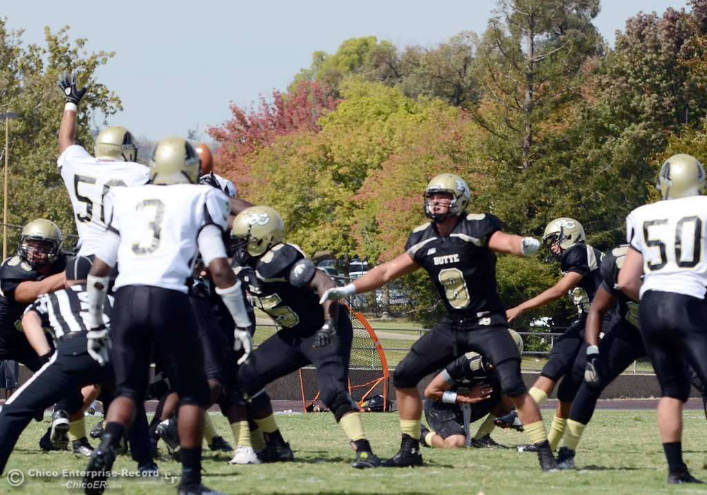 Description of . Butte College's #27 Rigoberto Sanchez kicks a field goal against Delta College in the second quarter of their football game at Butte's Cowan Stadium Saturday, September 28, 2013, in Oroville, Calif.  (Jason Halley/Chico Enterprise-Record)
