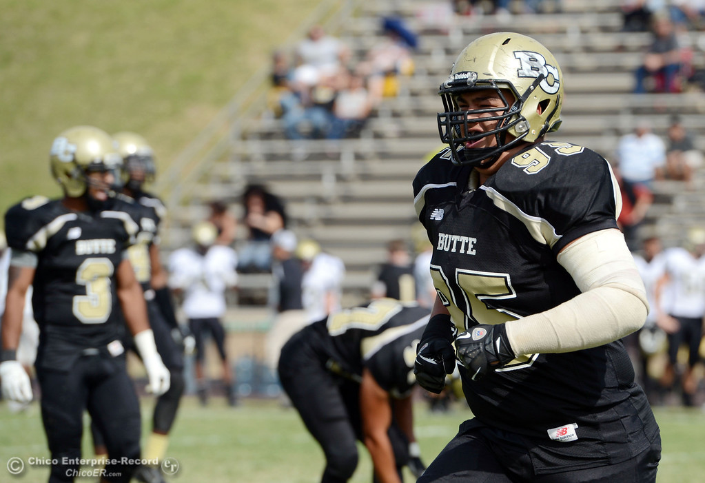 Description of . Butte College's #95 Mark Rosenquist comes off the field against Delta College in the third quarter of their football game at Butte's Cowan Stadium Saturday, September 28, 2013, in Oroville, Calif.  (Jason Halley/Chico Enterprise-Record)
