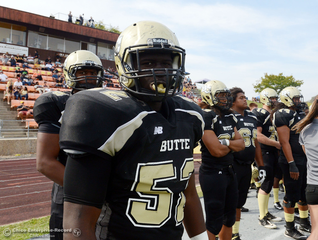Description of . Butte College's #52 Kyjuan Tate looks on against Delta College in the fourth quarter of their football game at Butte's Cowan Stadium Saturday, September 28, 2013, in Oroville, Calif.  (Jason Halley/Chico Enterprise-Record)