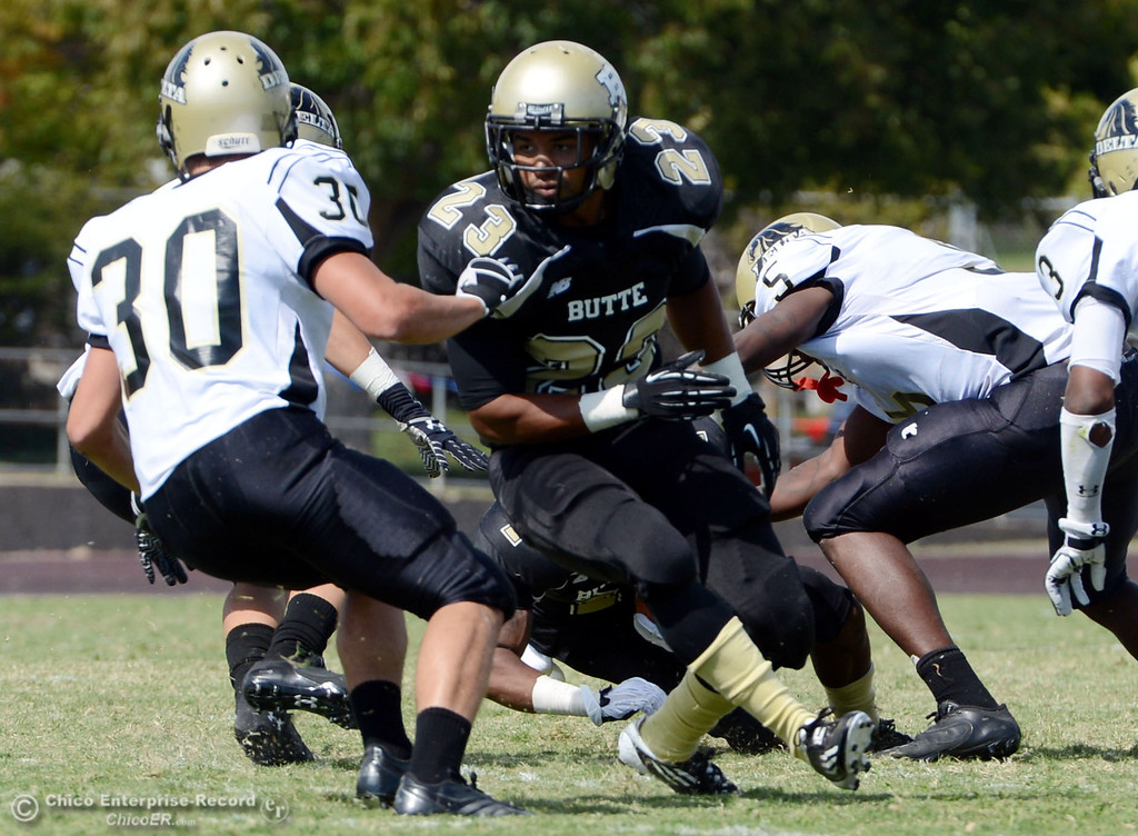 Description of . Butte College\'s #23 Mykah Hester (right) defends against Delta College\'s #30 Andrew Truax (left) in the second quarter of their football game at Butte\'s Cowan Stadium Saturday, September 28, 2013, in Oroville, Calif.  (Jason Halley/Chico Enterprise-Record)