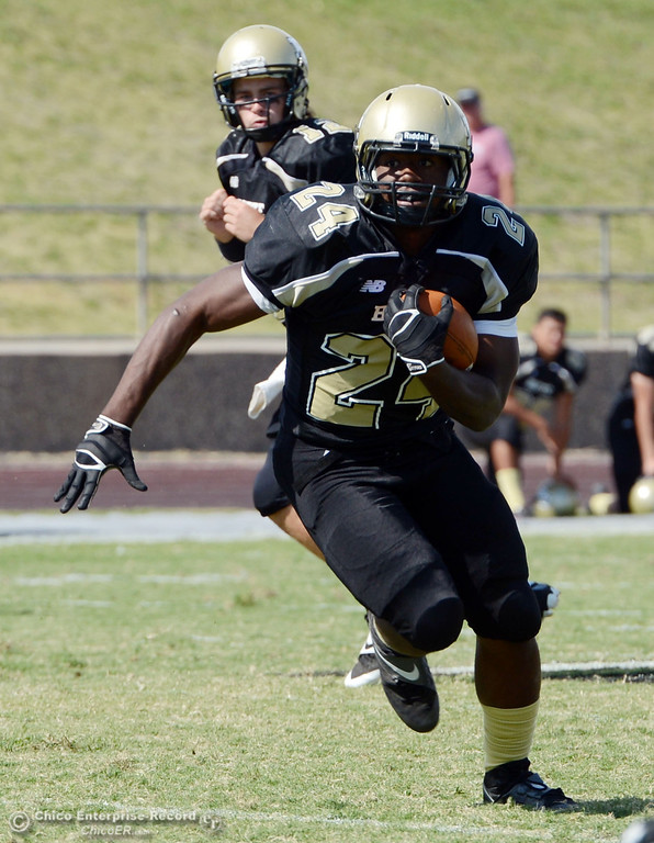 Description of . Butte Colleges\' #24 Kendall Williams rushes against Delta College in the second quarter of their football game at Butte\'s Cowan Stadium Saturday, September 28, 2013, in Oroville, Calif.  (Jason Halley/Chico Enterprise-Record)