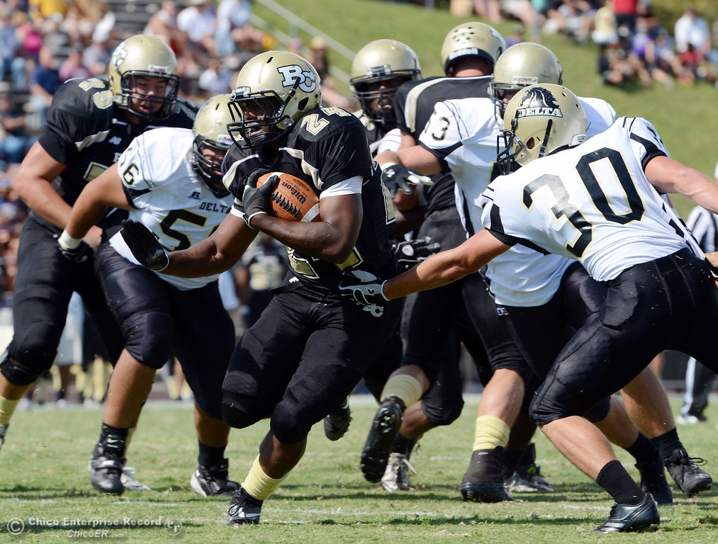 . Butte Colleges\' #24 Kendall Williams (left) rushes for a touchdown against Delta College\'s #30 Andrew Truax (right) in the second quarter of their football game at Butte\'s Cowan Stadium Saturday, September 28, 2013, in Oroville, Calif.  (Jason Halley/Chico Enterprise-Record)