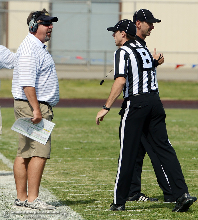 Description of . Butte College head coach Jeff Jordan (left) argues with official Will Camy (right) against Delta College in the second quarter of their football game at Butte\'s Cowan Stadium Saturday, September 28, 2013, in Oroville, Calif.  (Jason Halley/Chico Enterprise-Record)