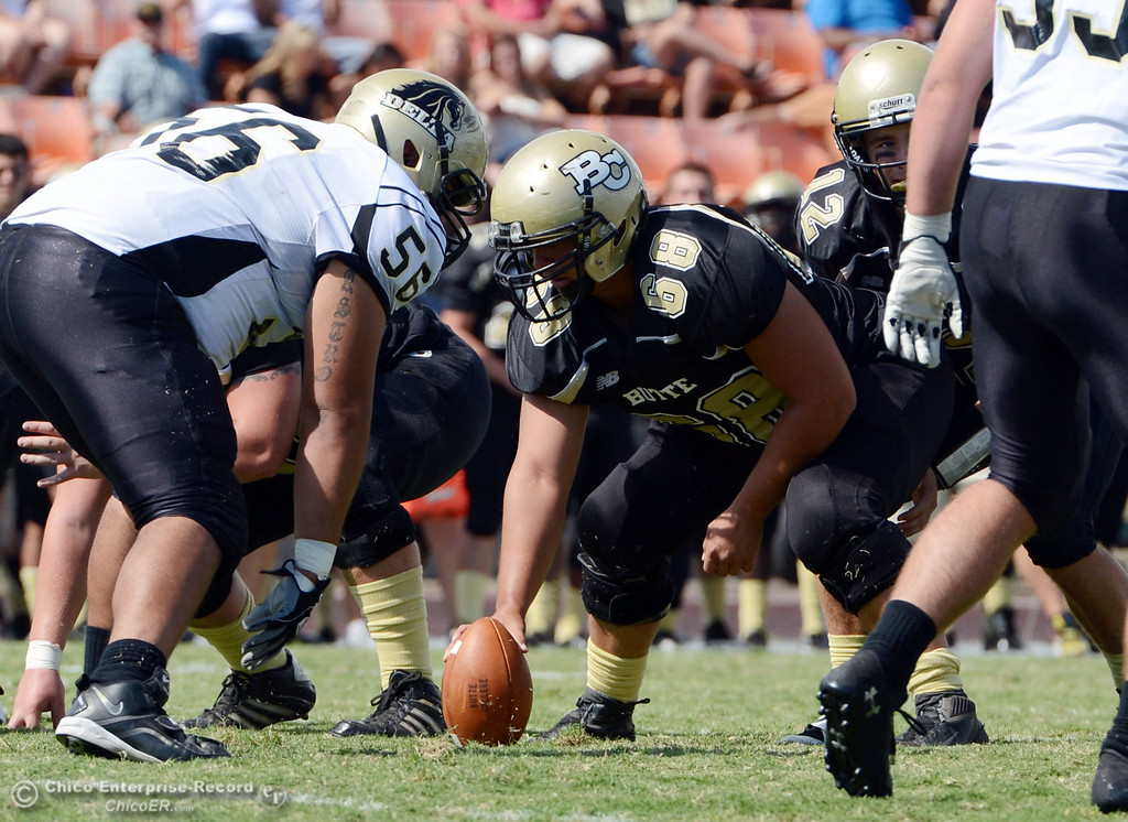 Description of . Butte College's #68 Eli Thom readies the snap against Delta College in the second quarter of their football game at Butte's Cowan Stadium Saturday, September 28, 2013, in Oroville, Calif.  (Jason Halley/Chico Enterprise-Record)