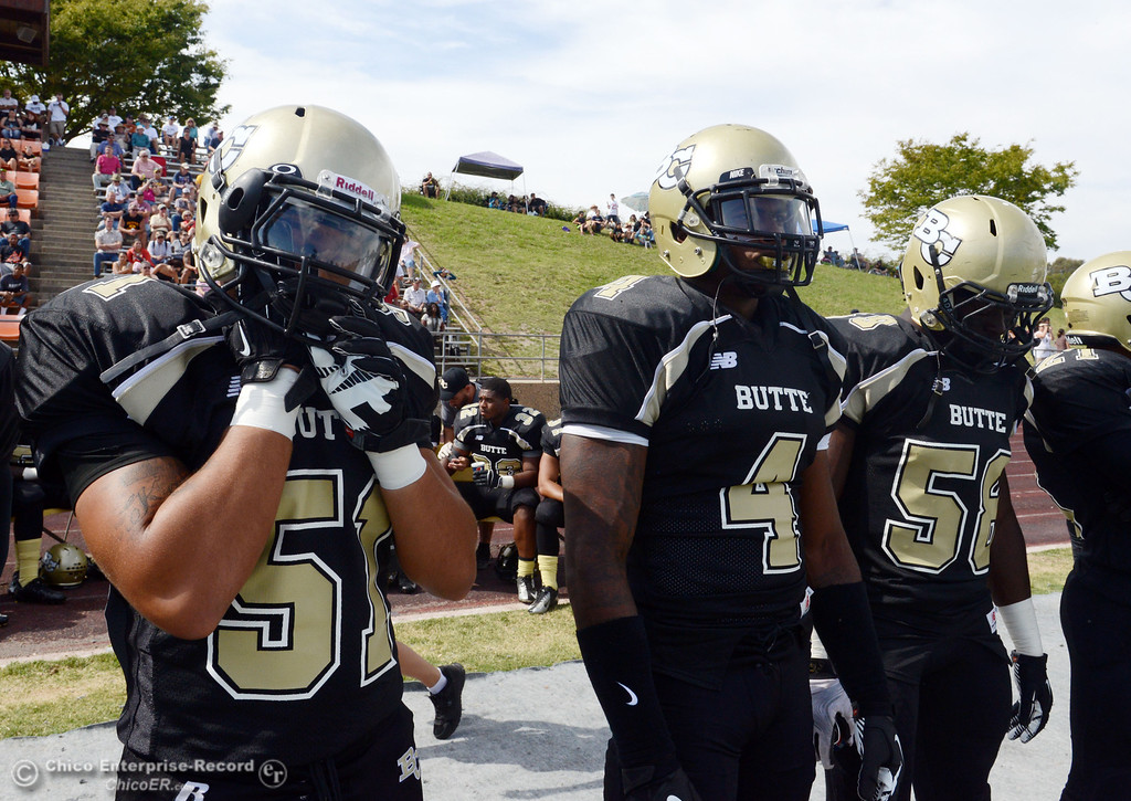 Description of . Butte College's #51 Izaya Johnson, #4 Chris Edwards, and #58 Sie Doe Jr. (left to right) against Delta College in the second quarter of their football game at Butte's Cowan Stadium Saturday, September 28, 2013, in Oroville, Calif.  (Jason Halley/Chico Enterprise-Record)