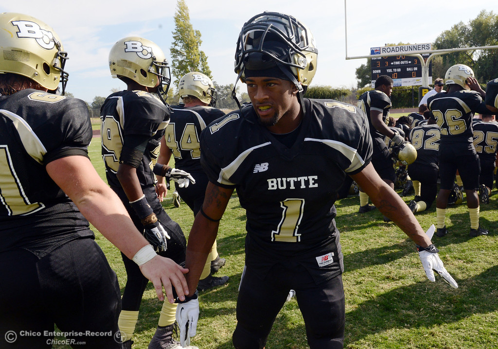 Description of . Butte College's #1 Wes McCoy congratulates the team against Delta College at the end of their football game at Butte's Cowan Stadium Saturday, September 28, 2013, in Oroville, Calif.  (Jason Halley/Chico Enterprise-Record)