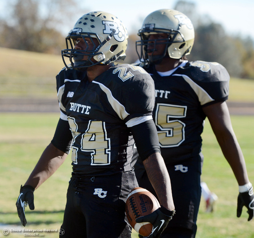 . Butte College\'s #24 Kendall Williams (left) and #55 Dominique Harris (right) against Fresno City College in the first quarter of their football game at Butte\'s Cowan Stadium Saturday, November 30, 2013 in Butte Valley, Calif.  (Jason Halley/Chico Enterprise-Record)