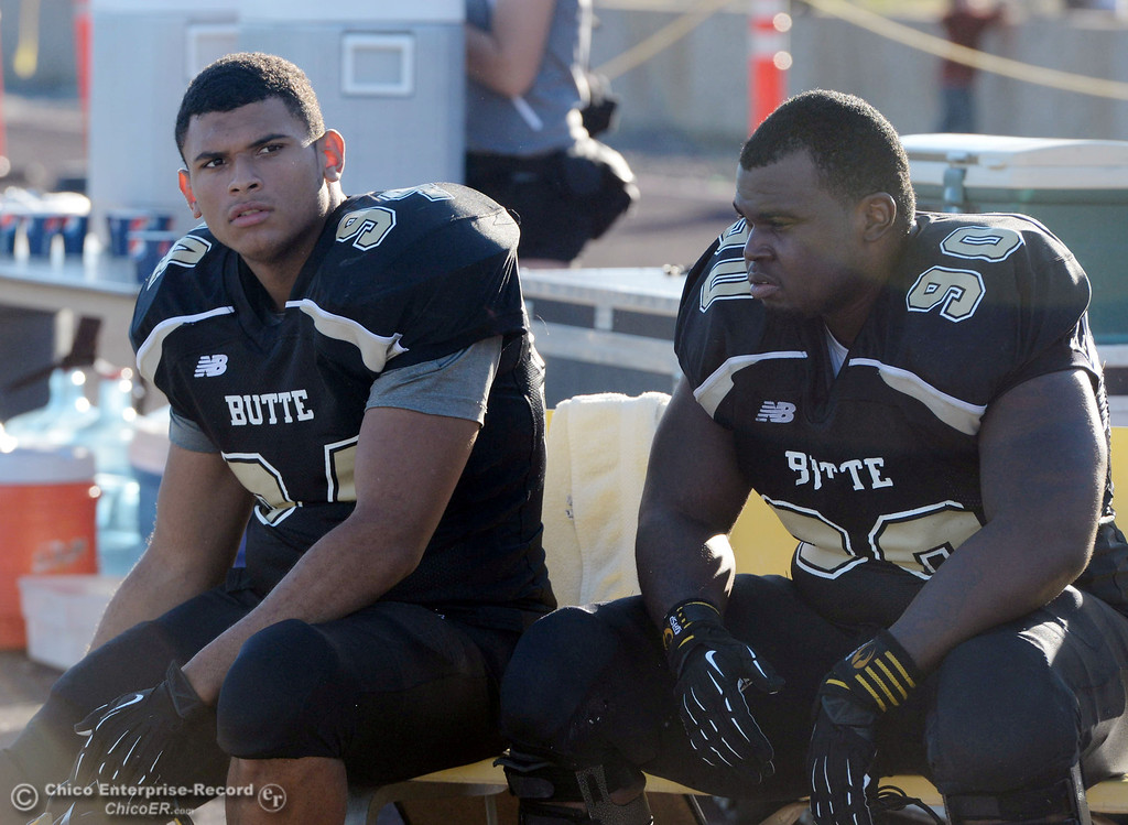 . Butte College\'s #94 Shannon Dinsdale (left) and #90 Stephen Francois (right) against Fresno City College in the fourth quarter of their football game at Butte\'s Cowan Stadium Saturday, November 30, 2013 in Butte Valley, Calif.  (Jason Halley/Chico Enterprise-Record)