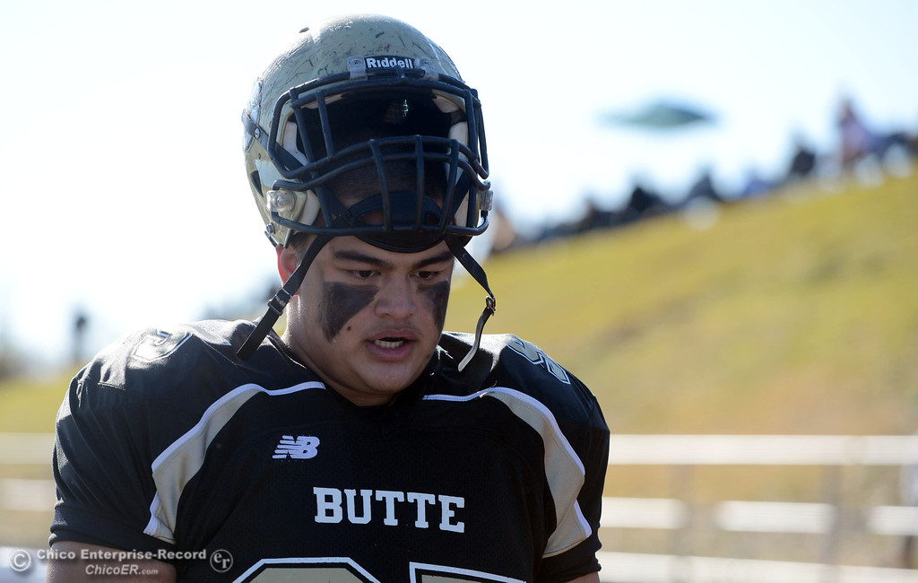 . Butte College\'s #95 Mark Rosenquist looks on against Fresno City College in the first quarter of their football game at Butte\'s Cowan Stadium Saturday, November 30, 2013 in Butte Valley, Calif.  (Jason Halley/Chico Enterprise-Record)