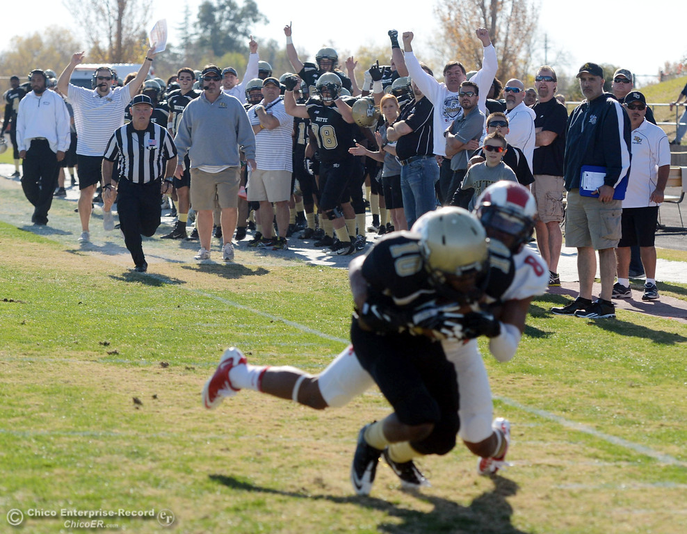 . Butte College sidelines reacts to a touchdown by CJ Grice against Fresno City College in the first quarter of their football game at Butte\'s Cowan Stadium Saturday, November 30, 2013 in Butte Valley, Calif.  (Jason Halley/Chico Enterprise-Record)