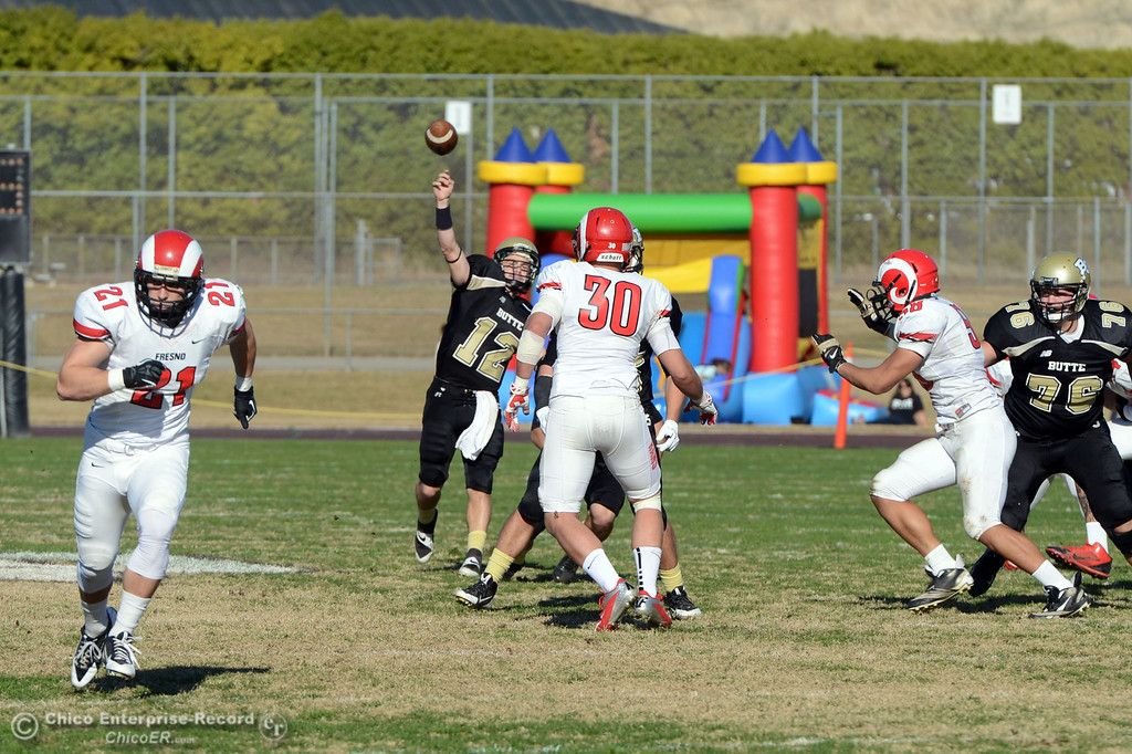 . Butte College\'s #12 Thomas Stuart throws a touchdown pass to #87 Timazray Shepherd against Fresno City College in the second quarter of their football game at Butte\'s Cowan Stadium Saturday, November 30, 2013 in Butte Valley, Calif.  (Jason Halley/Chico Enterprise-Record)